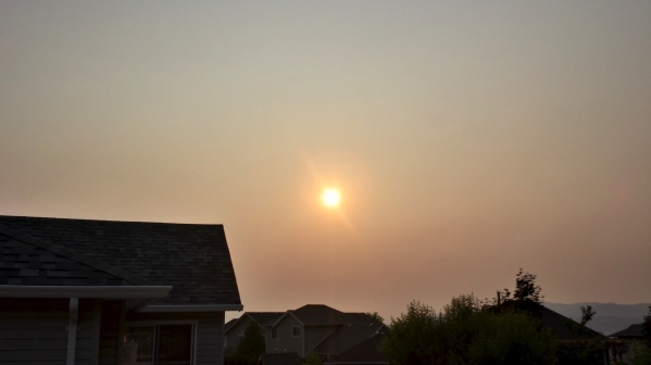 There's a bunch of forest fires burning nearby, which has resulted in super smokey skies and red sunrises.